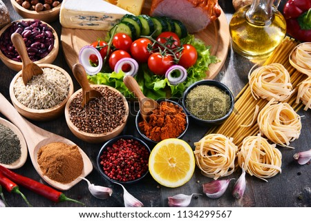 Composition with assorted organic food products on the table. #1134299567