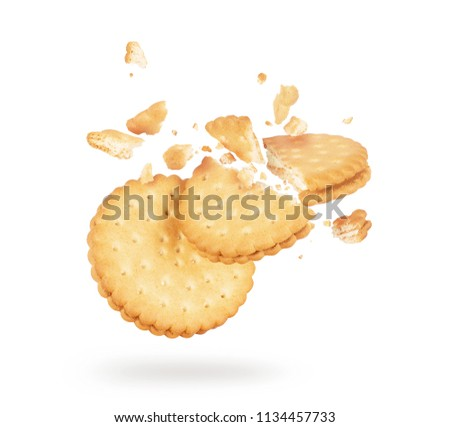 Biscuits crushed into pieces close-up isolated on a white background #1134457733