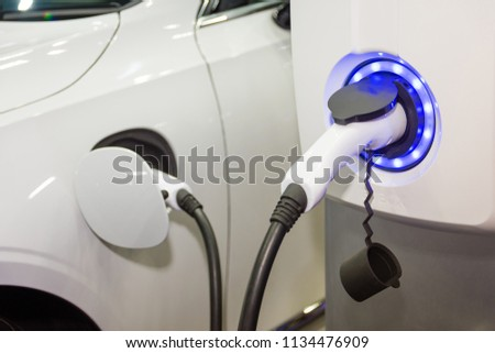Charging an electric car battery #1134476909