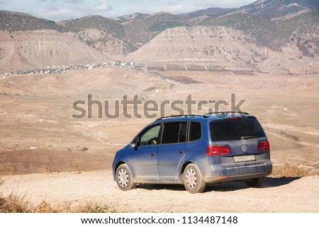 Volkswagen Sharan. The car is driving on the mountain Meganom. Republic of Crimea. October 30, 2015. #1134487148