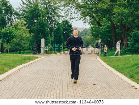 May 19 2018 Minsk Belarus Society Wings of Angels conducts an action BegoPark in Lositsky Park The man is running in the park #1134640073