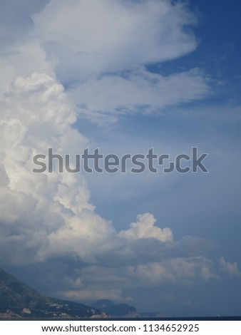 The beautiful natural delicious magnificent image of the view of the clouds above the seaside on a summer morning.   #1134652925