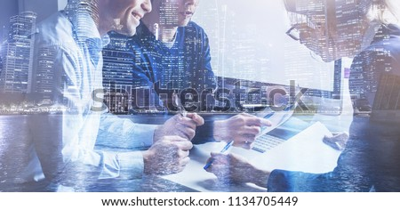 business team of coworkers working on startup in office, banner double exposure background of group of businessman people entrepreneurs  Royalty-Free Stock Photo #1134705449