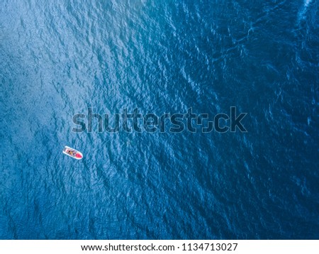 Top down view of a jet ski in the middle of the sea. #1134713027