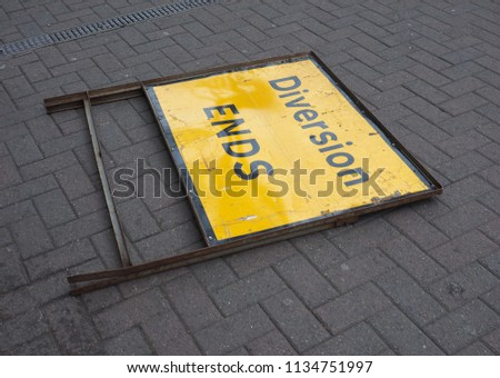 diversion ends sign fallen on the road #1134751997