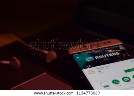BEKASI, WEST JAVA, INDONESIA. JULY 16, 2018 : Reuters News Application on Smartphone screen. Reuters News is a freeware web browser developed by Thompson Reuters #1134773069