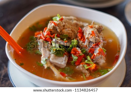 Hot and Spicy Soup with Pork Ribs on the table. Thai Food #1134826457
