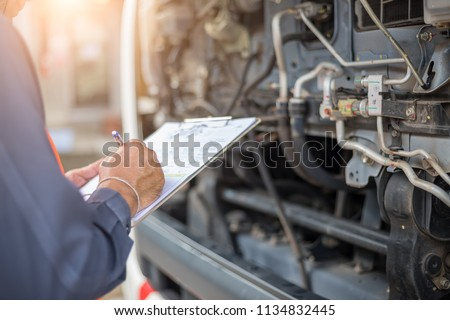 Preforming a pre-trip inspection on a truck,preventive maintenance,Check truck engine,Check the lubricating oil. #1134832445