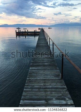 Colorful sunrise over pier with boats at Lake Tahoe in California, United States #1134836822
