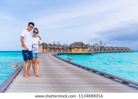 Asian couple sweetheart honeymoon traveling sea background, vacation holiday concepts with tropical Maldives island background. #1134888056