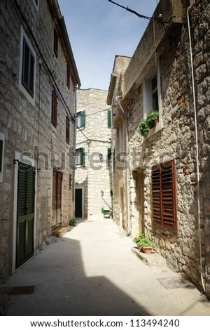 Old narrow street in stone, Croatia #113494240