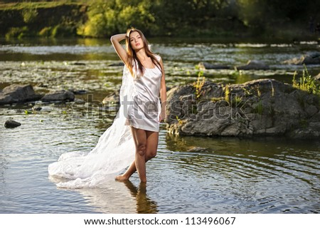 Portrait of yang sexy woman on sunset river. #113496067