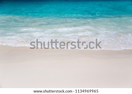 The beach with white sand and turquoise water with waves #1134969965