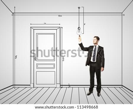 businessman drawing abstract plan interior