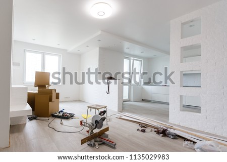 Interior of apartment with materials during on the renovation and construction ( remodel wall from gypsum plasterboard or drywall) #1135029983