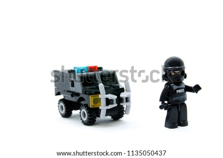 Toy jigsaw of police jail car with an officer