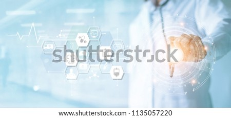 Medicine doctor and stethoscope in hand touching icon medical network connection with modern virtual screen interface, medical technology network concept #1135057220
