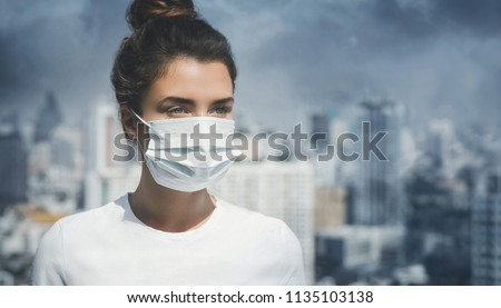 Woman wearing face mask because of air pollution in the city #1135103138