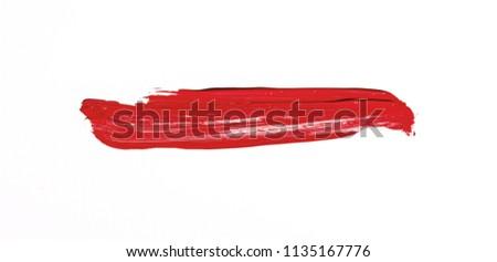 Red brush stroke isolated over white background #1135167776