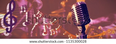 Close-up of microphone  against mid section of male guitarist performing with female drummer #1135300028