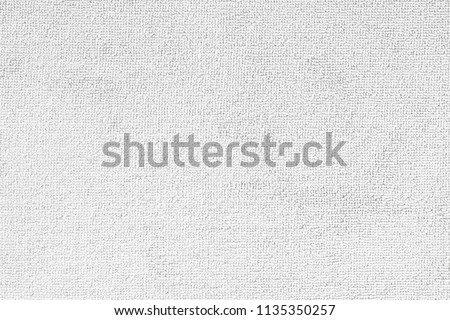 Carpet or white beach towel texture background in beige color made of wool or synthetic fibers, polypropylene, nylon or polyester material #1135350257