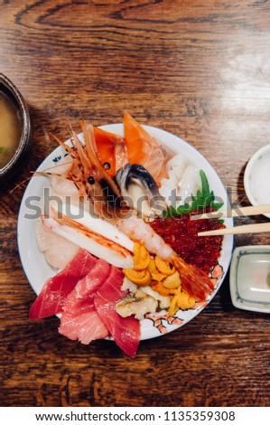 Kaisendon premium Japanese sashimi rice bowl on wood table top view shot #1135359308
