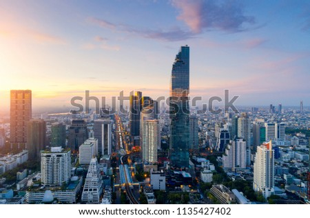 Aerial view of Bangkok modern office buildings, condominium, living place in Bangkok city downtown with sunset scenery, Bangkok is the most populated city in Southeast Asia.Bangkok , Thailand #1135427402