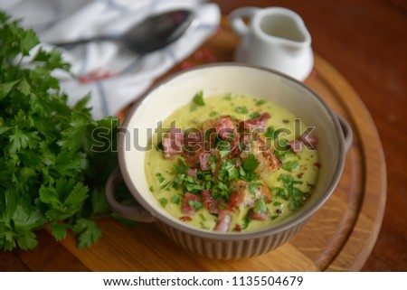 Fresh Soup with croutons and ham on a wooden table #1135504679