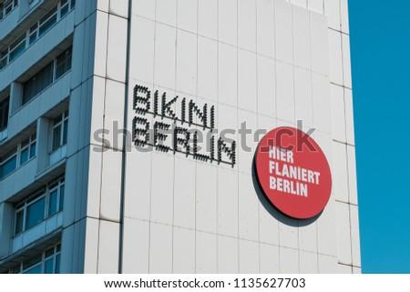 "Berlin, Germany - july 2017: Advertising for ""Bikini Berlin"" (formally Bikinihaus) , a concept shopping center at Zoo Berlin, Germany #1135627703"