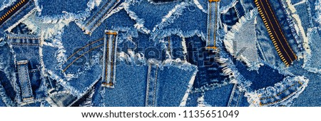 Denim blue jeans fabric frame. Ripped denim fabric , text place, copy space.   Destroyed torn denim blue jeans patches, banner background. Recycle old jeans denim concept #1135651049