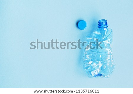 used plastic bottle on blue background, flat lay, copy space for your text #1135716011