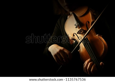 Violin player. Violinist hands playing violin orchestra musical instrument closeup #1135767536