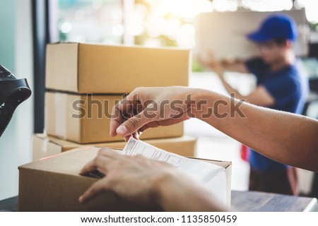 Home delivery service and working service mind, Woman working barcode scan to confirm sending customer in post office. #1135850459