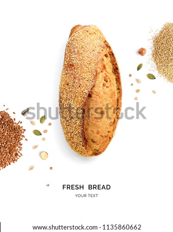 Creative layout made of bread and nuts. Flat lay. Food concept. Macro  concept. Bread, quinoa and flax seeds on white background. #1135860662