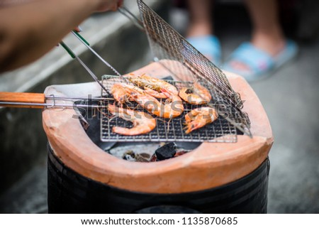 Grilled shrimps on the flaming grill. #1135870685