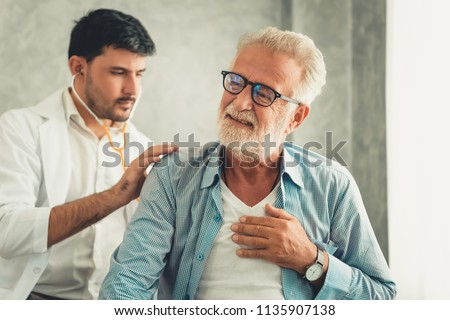 Portrait of doctor is examining physical symptom of senior patient in examination room., Healthcare and occupational concept. #1135907138