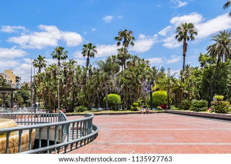 MALAGA, SPAIN - JUNE 2, 2018: Marina Square (Plaza de la Marina) - main square of Malaga, was designed in XIX century, located in front of main entrance of Port. #1135927763