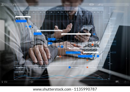 Project manager working and update tasks with milestones progress planning and Gantt chart scheduling virtual diagram.Business team meeting. Photo professional investor working new start up project.  #1135990787