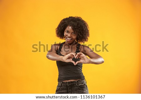 I kiss you. Portrait of attractive woman with kiss on lips. Orange studio. Beautiful female portrait. Young happy emotional funny woman looking at camera. Human facial emotions concept. Trendy colors #1136101367