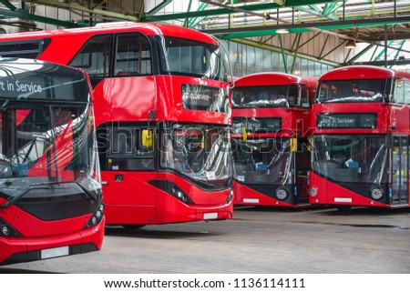 Red double-decker buses at Ash Grove garage in Hackney, East London  #1136114111