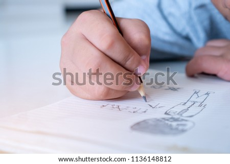 Student's hand Studying Drawing on paper for creation picture abstract of painting with Art subject classroom High school secondary education #1136148812