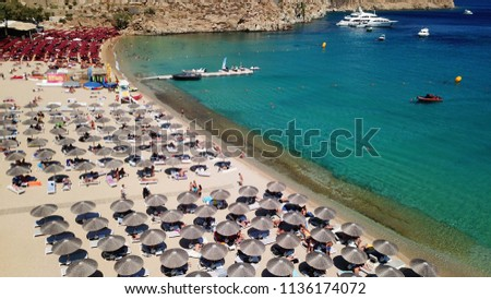 Aerial drone, bird's eye view photo of iconic and famous beach of Super Paradise with sapphire and emerald clear water sea, Mykonos island, Cyclades, Greece #1136174072