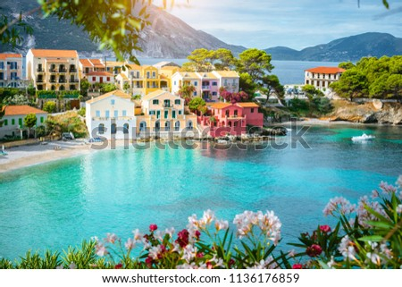 Turquoise colored bay in Mediterranean sea with beautiful colorful houses in Assos village in Kefalonia, Greece #1136176859