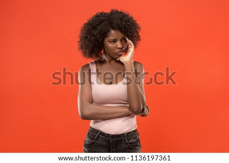 Remember all. Let me think. Doubt concept. Doubtful, thoughtful woman remembering something. Young emotional woman. Human emotions, facial expression concept. Studio. Isolated on trendy red. Front #1136197361