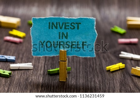 Text sign showing Invest In Yourself. Conceptual photo Improve your Skills take courses Do masters Scholarship Clips symbol idea script notice board text capital cardboard design. #1136231459