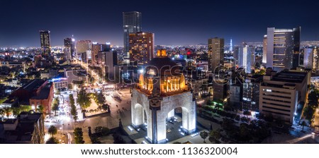 Panoramic aerial view of the famous monument to the revolution at night illuminated with the lights of the city #1136320004