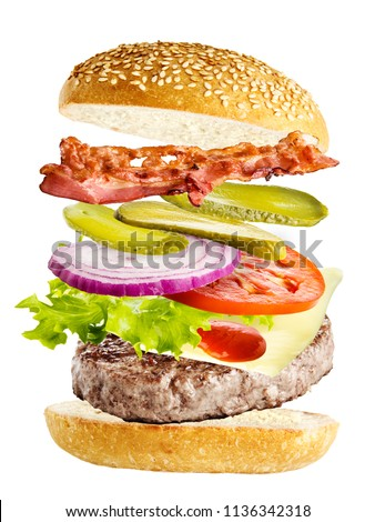 burger with flying ingredients isolated on white background #1136342318