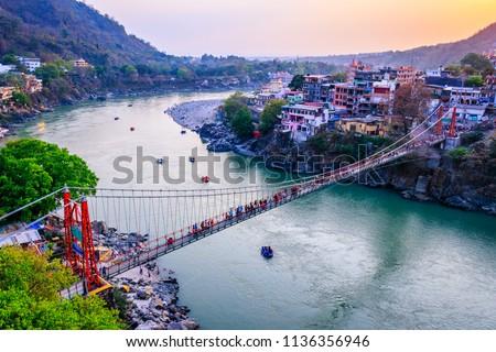 Rishikesh, yoga city India, Ganges River Ganga Ram Jhoola (Bridge).People enjoying rafting  #1136356946