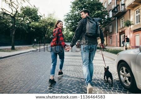 happy hipster couple with bulldog , summer vacation. stylish family with funny dog resting  #1136464583