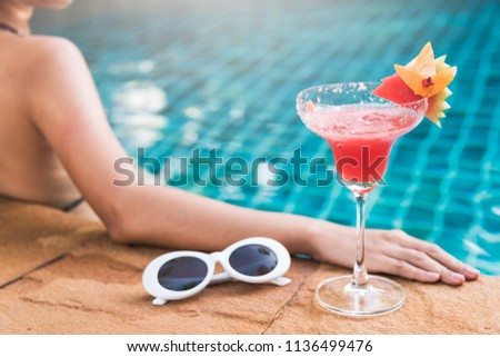 Happy young back woman in bikini swimming pool drink cocktail luxury at the resort, vacation travel summer holiday concept